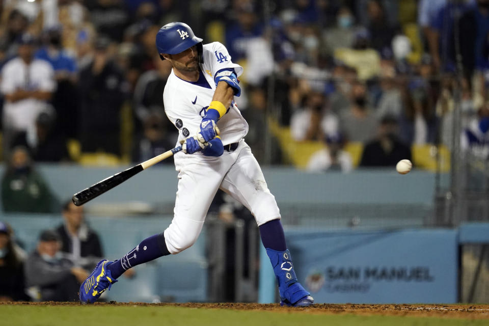 Los Angeles Dodgers' AJ Pollock drives in a run with a single during the eighth inning against the Atlanta Braves in a baseball game Wednesday, Sept. 1, 2021, in Los Angeles. (AP Photo/Marcio Jose Sanchez)