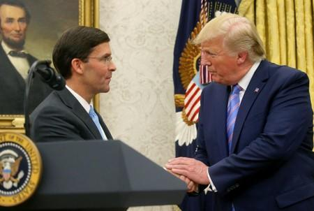 U.S. President Donald Trump shakes hands with Mark Esper after Esper was sworn in as the new Secretary of Defense in the Oval Office of the White House in Washington