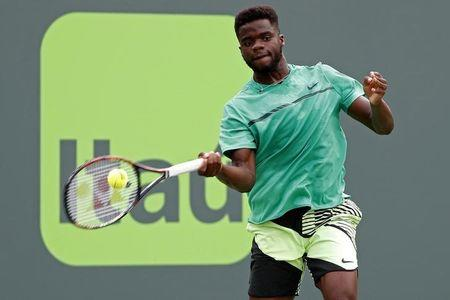 Mar 25, 2017; Miami, FL, USA; Frances Tiafoe of the United States hits a forehand against Roger Federer of Switzerland (not pictured) on day five of the 2017 Miami Open at Crandon Park Tennis Center. Federer won 7-6(2), 6-3. Mandatory Credit: Geoff Burke-USA TODAY Sports