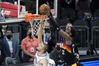 Phoenix Suns center Deandre Ayton, right, scores over Los Angeles Clippers center Ivica Zubac during the first half of Game 2 of the NBA basketball Western Conference Finals, Tuesday, June 22, 2021, in Phoenix. (AP Photo/Matt York)