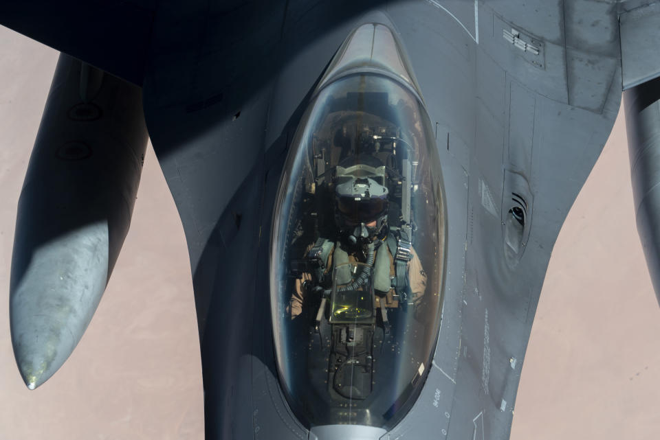 "U.S. Air Force F-16 Fighting Falcon is aerial refueled by a KC-135 ""Stratotanker"" over the U.S. Central Command area of responsibility Wednesday, Dec. 30, 2020 as part of an escort mission in support of the B-52 ""Stratofortress"" deployment. The United States flew strategic bombers over the Persian Gulf on Wednesday for the second time this month, a show of force meant to deter Iran from attacking American or allied targets in the Middle East. (Senior Airman Roslyn Ward/U.S. Air Force via AP)"