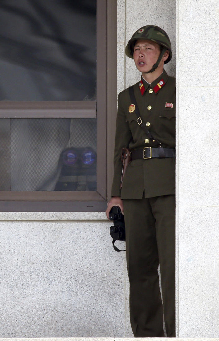 """A North Korean soldier watches the South Korean side at the border village of Panmunjom in the demilitarized zone (DMZ) in South Korea Thursday, April 4, 2013. South Korea's defense minister said Thursday North Korea has moved a missile with """"considerable range"""" to its east coast, but said it is not capable of hitting the United States. (AP Photo/Yonhap, Lee Jong-hoon) KOREA OUT"""