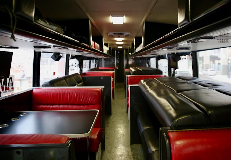 The refurbished bus features TVs, a kitchenette, washroom and fold out bunkbeds. (Photo: Samantha Beattie/HuffPost Canada)
