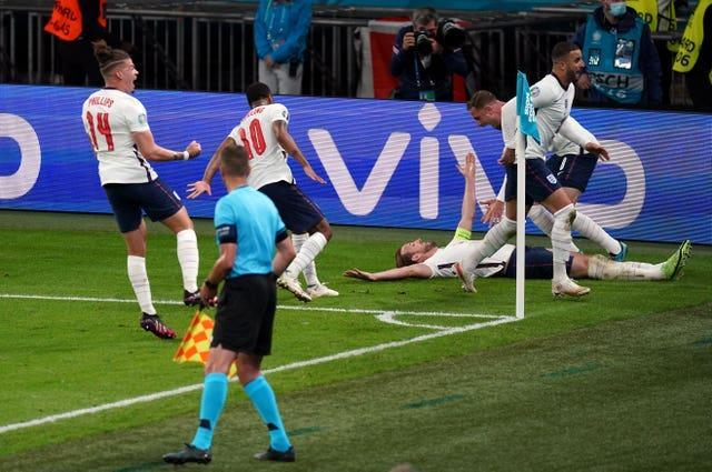 Harry Kane, 3rd right, celebrates his goal against Denmark with his England team-mates