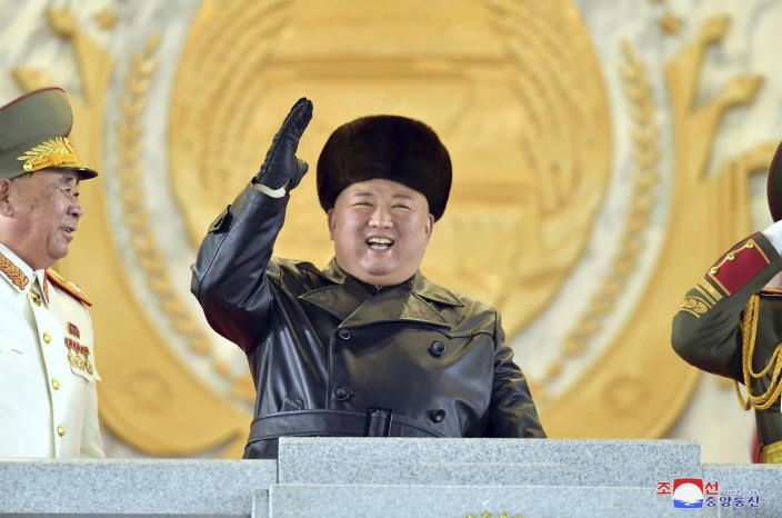 """In this photo provided by the North Korean government, North Korean leader Kim Jong Un waves as Kim attended a military parade, marking the ruling party congress, at Kim Il Sung Square in Pyongyang, North Korea Thursday, Jan. 14, 2021. Independent journalists were not given access to cover the event depicted in this image distributed by the North Korean government. The content of this image is as provided and cannot be independently verified. Korean language watermark on image as provided by source reads: """"KCNA"""" which is the abbreviation for Korean Central News Agency. (Korean Central News Agency/Korea News Service via AP)"""