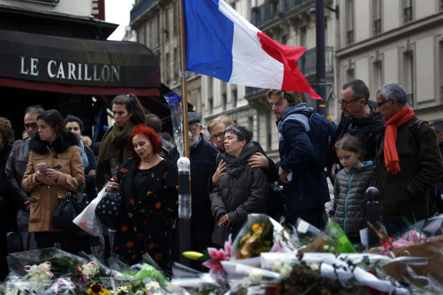 People gather in front of Le Carillon cafe, a site of terrorist attacks in Paris, Nov. 16, 2015. (Photo: Jerome Delay/AP)
