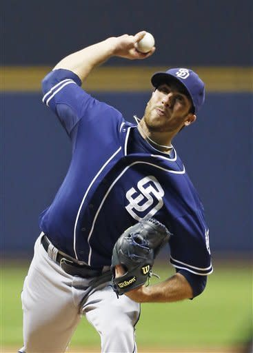 San Diego Padres' Anthony Bass pitches to a Milwaukee Brewers batter during the first inning of a baseball game Tuesday, Oct. 2, 2012, in Milwaukee. (AP Photo/Tom Lynn)