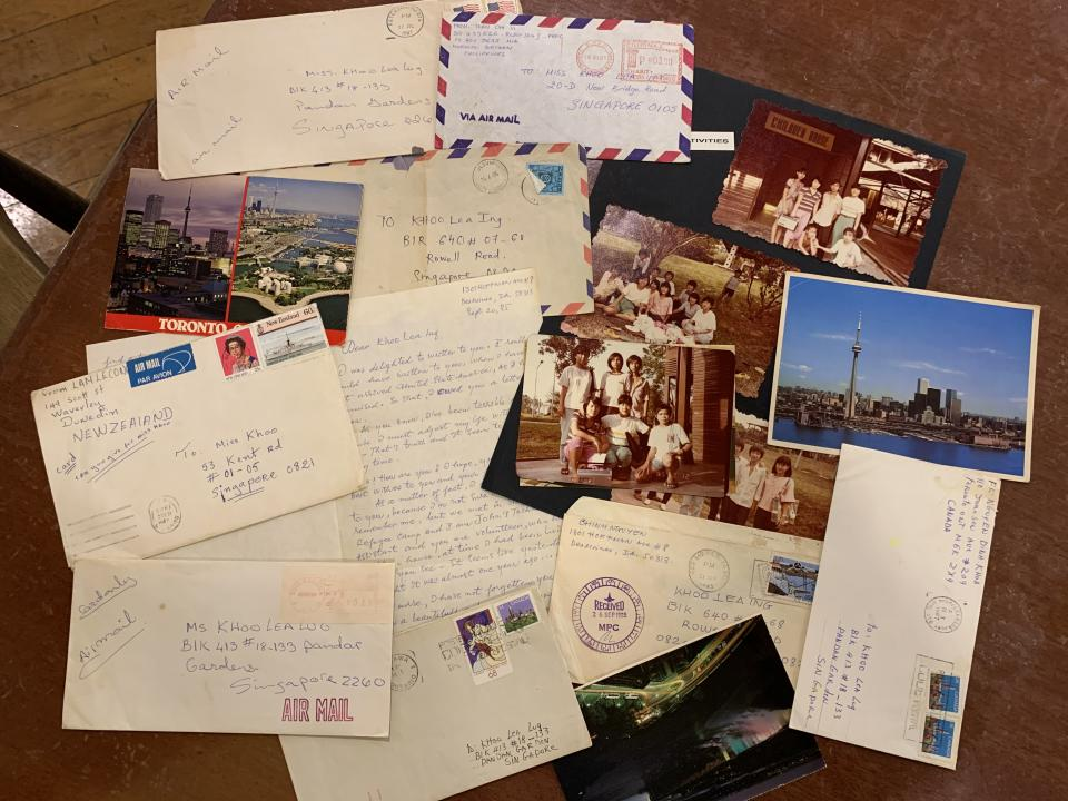 Some of the letters and postcards sent by the Vietnamese refugee children Alvina Khoo once watched over, from countries like the United States, New Zealand, Norway and Canada. PHOTO: Nicholas Yong/Yahoo News Singapore