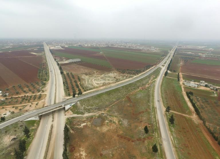 Syria's M5 highway connects the once economic hub of Aleppo in the north to the capital Damascus then continues south to the Jordanian border (AFP Photo/Muhammad HAJ KADOUR)
