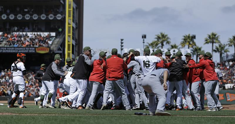Buster Posey stood on the outside of the brawl but became a central figure. (AP)