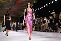 """<p>Dua Lipa opened and closed the Versace show, which this season took inspiration from the transformative powers of the house's iconic silk foulard, or scarves, taking pieces of fabric and """"haphazardly"""" fastening and embellishing with another recognisable brand signature; the safety pin. </p><p>""""The foulard is a fundamental component of Versace's heritage and character,"""" said Donatella Versace. """"It's acted as a canvas for our iconic prints and is worn in multiple ways from knotted tops to headscarves to bag accessories - it's a way of adding Versace attitude to any look. The foulard has been with us since the very beginning of the brand, but this season turns everything on its head, it is no longer fluid or dreamy, the scarf is provocative, sexy, wound tight."""" </p>"""