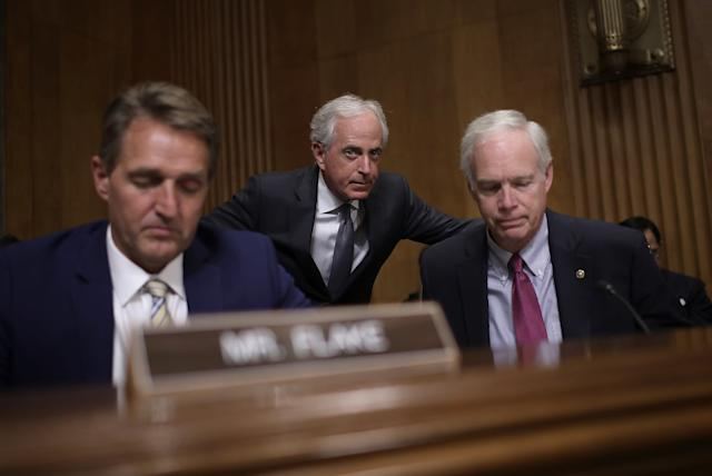Sen. Bob Corker (R-Tenn.), center, chairman of the Senate Foreign Relations Committee, confers with Sen. Ron Johnson (R-Wis.), right, during a committee hearingNov. 14in Washington, D.C. Also pictured is Sen. Jeff Flake (R-Ariz.). (Win McNamee via Getty Images)
