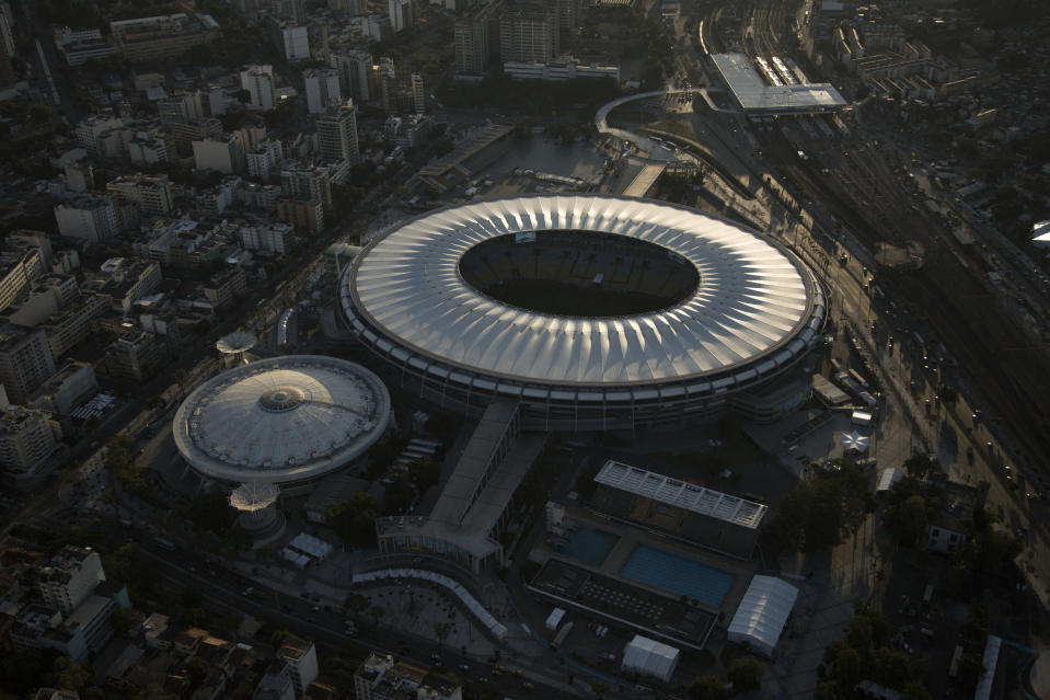 FILE - This June 8, 2014 file photo, shows an aerial view of Maracana stadium, in Rio de Janeiro, Brazil. Rio's state legislature voted the second week of March 2021, to give Gov. Claudio Castro the authority to rename the stadium after soccer great Pele, officially Edson Arantes do Nascimento - Rei Pel.. (AP Photo/Felipe Dana, File)