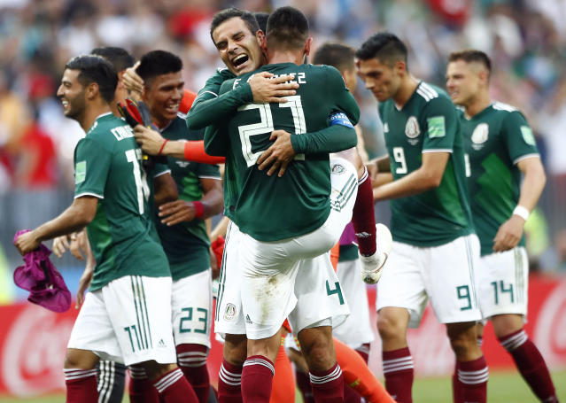 Mexico players celebrate after winning the group F match between Germany and Mexico at the 2018 soccer World Cup in the Luzhniki Stadium in Moscow, Russia, Sunday, June 17, 2018. Mexico won 1-0. (AP Photo/Matthias Schrader)