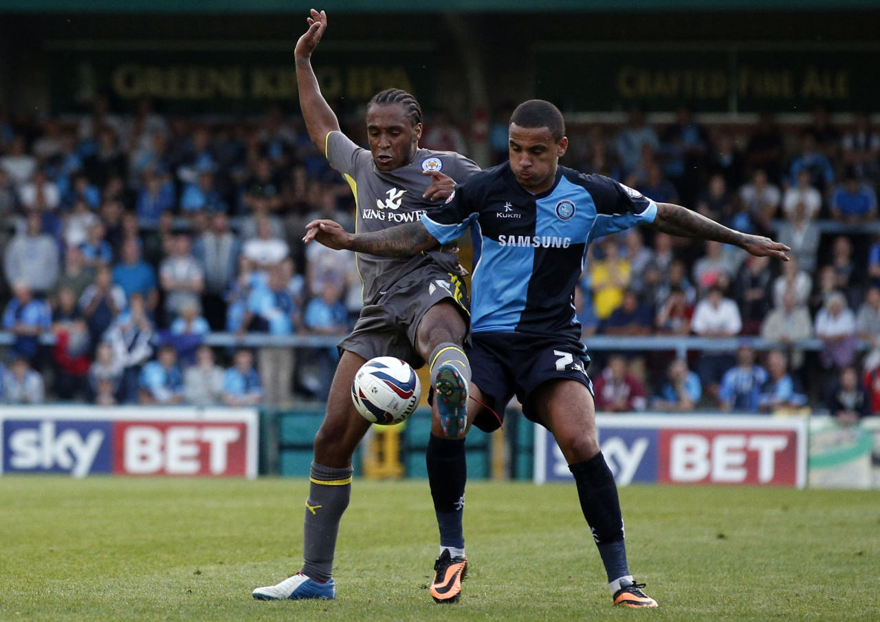 Leicester's Neil Danns (left) wrestles with Wycombe's Dean Morgan (right) during the Capital One Cup, First Round match at Adams Park, Wycombe.