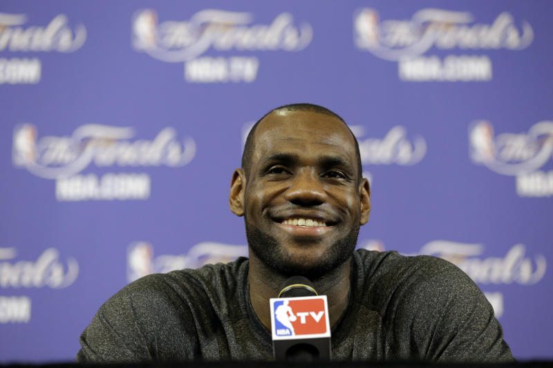 Miami Heat small forward LeBron James smiles as he speaks during a news conference before NBA basketball practice, Wednesday, June 19, 2013 at the American Airlines Arena in Miami. The Heat host the San Antonio Spurs in Game 7 of the NBA Finals on Thursday. (AP Photo/Wilfredo Lee)
