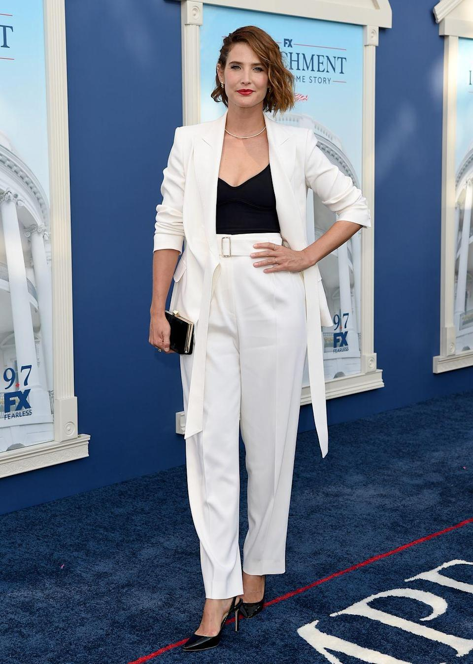 <p><strong>1 September </strong></p><p>Cobie Smulders went for monochrome in a white soft-tailored suit and black accessories. </p>