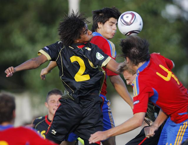 Alvaro Morata (C) of Spain vies for the ball with Pierre-Yves Ngawa (L) of Belgium during their UEFA European Under-19 Championship 2010/2011 football final tournament in Mogosoaia village, next to Bucharest on July 21, 2011. AFP PHOTO/ STRINGER (Photo credit should read -/AFP/Getty Images)