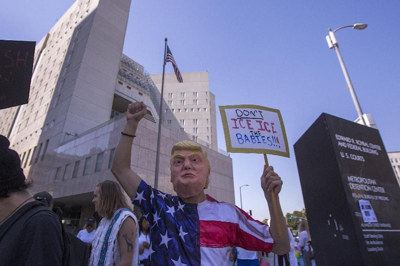 Protesters decrying Trump administration immigration policy march past the Metropolitan Detention Center, which houses detained immigrants, on June 30 in Los Angeles