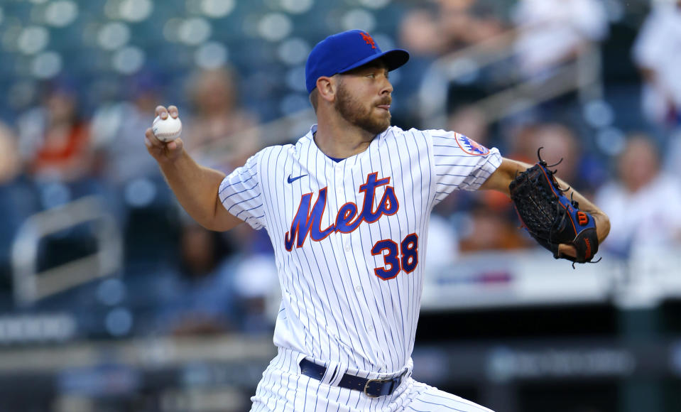 New York Mets starting pitcher Tylor Megill pitches against the Atlanta Braves during the first inning of a baseball game Wednesday, June 23, 2021, in New York. (AP Photo/Noah K. Murray)
