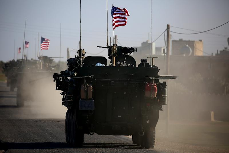 Since 2014 the US-led coalition has provided weapons, training and other support to forces fighting Islamic State group (IS) jihadists in Syria and Iraq (AFP Photo/DELIL SOULEIMAN)