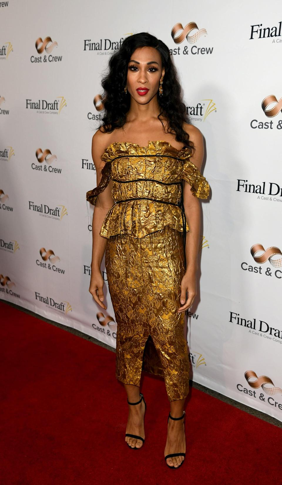 <p>Mj needed nothing but simple Jimmy Choo sandals to accessorize this jacquard midi at the 15th Annual Final Draft Awards in January 2020.</p>