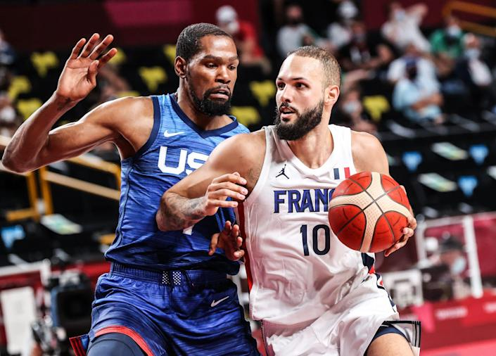 Evan Fournier of France drives to the basket as Kevin Durant of USA guards him.