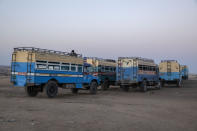 Empty buses are parked for Tigray refugees who fled the conflict in the Ethiopia's Tigray, at Hamdeyat Transition Center near the Sudan-Ethiopia border, eastern Sudan, Thursday, Dec. 3, 2020. Ethiopian forces on Thursday blocked people from the country's embattled Tigray region from crossing into Sudan at the busiest crossing point for refugees, Sudanese forces said.(AP Photo/Nariman El-Mofty)