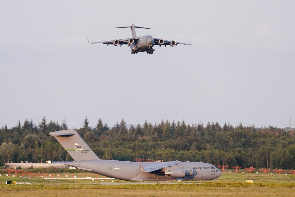 A transport plane carrying people flown out of Afghanistan lands at Ramstein Air Base, in Ramstein-Miesenbach, Germany. (Uwe Anspach/dpa via AP)