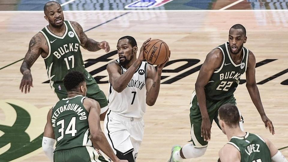 Nets Kevin Durant surrounded by Bucks Game 3