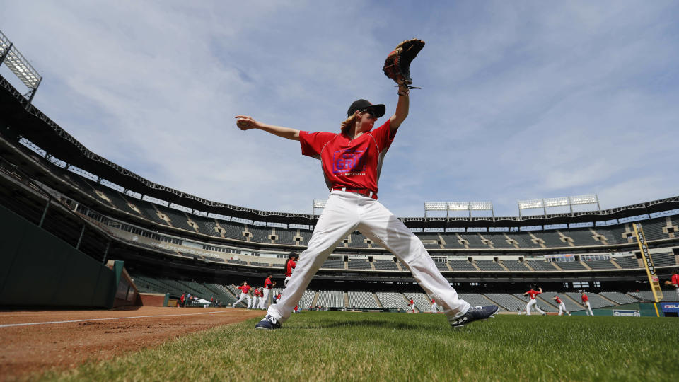Arwen Naomi McCullough, of Livermore, Calif., warms up before a baseball game in Arlington, Texas, Friday, March 8, 2019. More than 60 high school girls from the United States, as well as Canada and Puerto Rico are taking part in the inaugural MLB Grit event, a tournament specifically for girls who play baseball. (AP Photo/LM Otero)