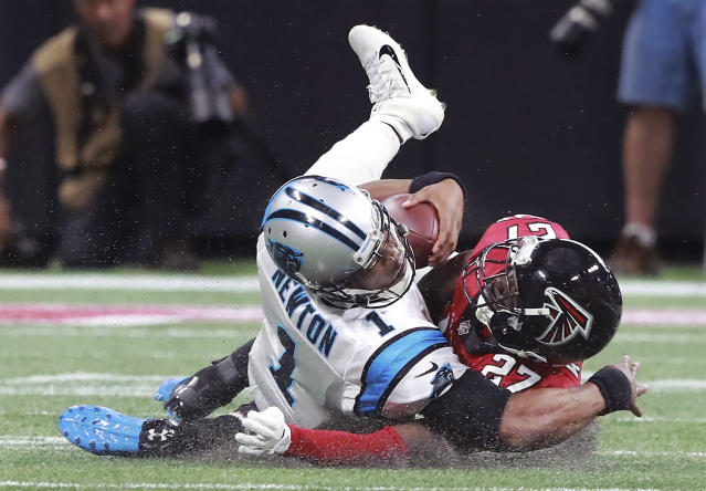 Falcons safety Damontae Kazee levels Panthers quarterback Cam Newton and is ejected from the game. (AP)