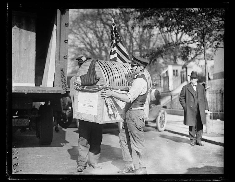 """<p>Back in 1921, H.W. Mason of Crystal Springs, Miss., gifted a turkey — which, like Wilson's bird, arrived in its own personal crate — to President Warren G. Harding. Look closely, and you can see """"Warren G. Harding"""" clearly printed on the side. <i><i>(Photo: Library of Congress)</i></i></p>"""