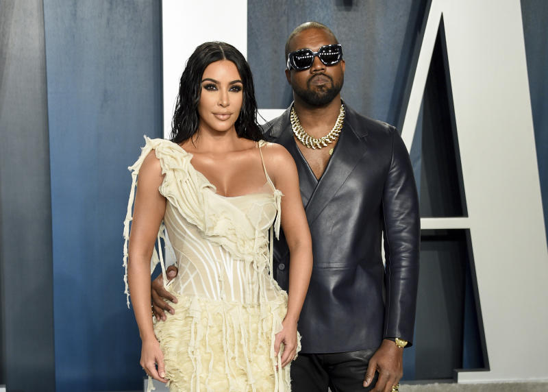 Kim Kardashian West, left, and Kanye West arrive at the Vanity Fair Oscar Party on Sunday, Feb. 9, 2020, in Beverly Hills, Calif.