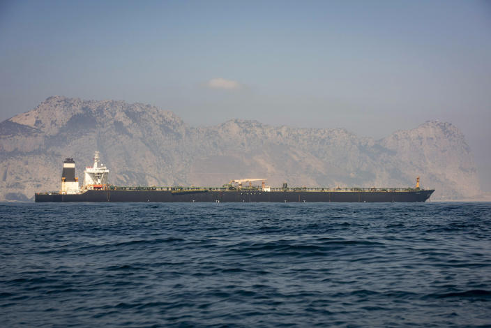 A view of the Grace 1 supertanker in the British territory of Gibraltar, Thursday, Aug. 15, 2019, seized last month in a British Royal Navy operation off Gibraltar. The United States moved on Thursday to halt the release of the Iranian supertanker Grace 1, detained in Gibraltar for breaching EU sanctions on oil shipments to Syria, thwarting efforts by authorities in London and the British overseas territory to defuse tensions with Tehran. (AP Photo/Marcos Moreno)