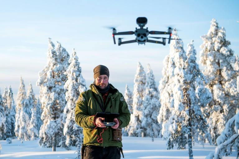 When snow is scarce, Daniel Viklund uses a drone to help herd the reindeer, as well as GPS collars