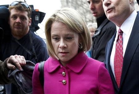 New Jersey Governor Chris Christie's former deputy chief of staff Bridget Anne Kelly makes her way through a crush of media with her attorney as she arrives at Mercer County Court in Trenton, New Jersey, March 11, 2014. REUTERS/Mike Segar