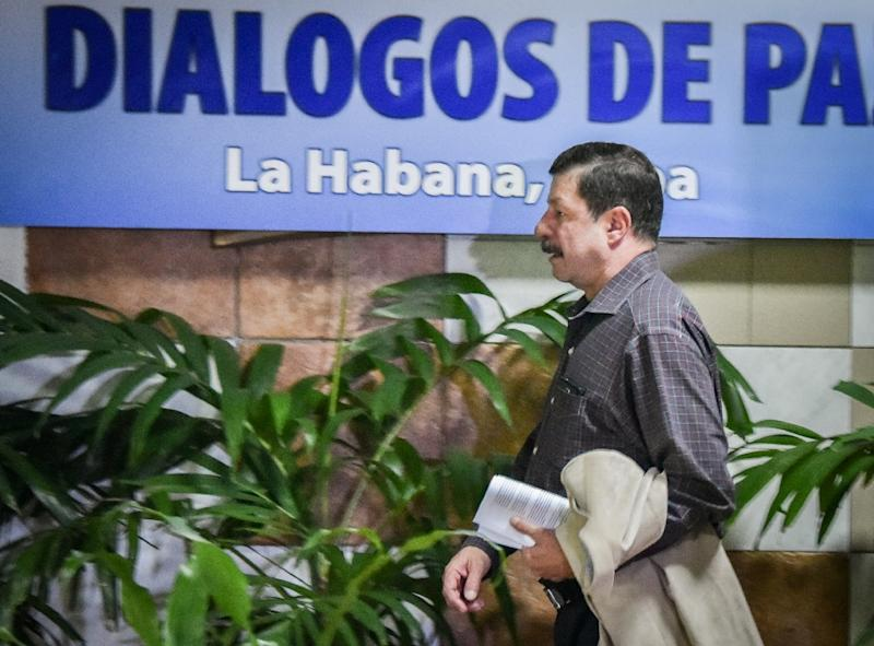 A member of the Colombian government delegation at peace talks with the Revolutionary Armed Forces of Colombia (FARC), arrives at Convention Palace in Havana, on July 23, 2015 (AFP Photo/Adalberto Roque)