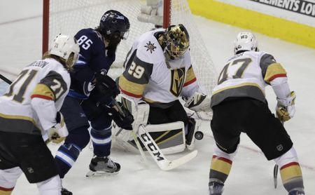 May 20, 2018; Winnipeg, Manitoba, CAN; Vegas Golden Knights goaltender Marc-Andre Fleury (29) makes a save as Winnipeg Jets center Mathieu Perreault (85) looks for the rebound in the second period in game five of the Western Conference Final of the 2018 Stanley Cup Playoffs at Bell MTS Centre. Mandatory Credit: James Carey Lauder-USA TODAY Sports