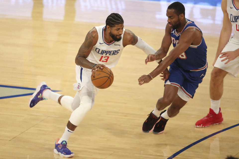 Los Angeles Clippers shooting guard Paul George (13) controls the ball against New York Knicks shooting guard Alec Burks (18) during the first half of an NBA basketball game Sunday, Jan. 31, 2021, in New York. (Brad Penner/Pool Photo via AP)