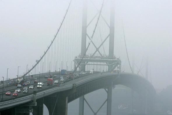 High winds blow over lorry and trailer on Forth Bridge