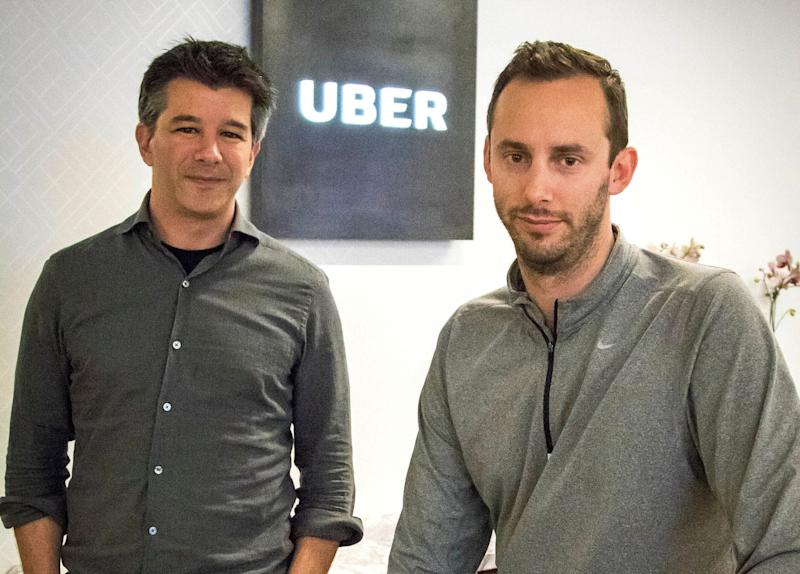 FILE - In this Aug. 18, 2016, file photo, Uber CEO Travis Kalanick, left, and Anthony Levandowski, co-founder of Otto, pose for a photo in the lobby of Uber headquarters, in San Francisco. Former Uber CEO Kalanick returned to a courtroom Wednesday, Feb. 7, 2018, to deal with questions about his discussions with Levandowski, an engineer accused of stealing Google's self-driving car technology. (AP Photo/Tony Avelar, File)