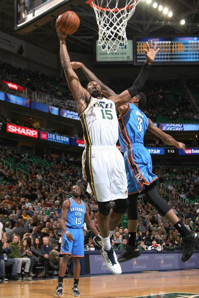 SALT LAKE CITY, UT - JANUARY 07: Derrick Favors #15 of the Utah Jazz shoots the layup against Perry Jones #3 of the Oklahoma City Thunder at EnergySolutions Arena on January 07, 2014 in Salt Lake City, Utah. (Photo by Melissa Majchrzak/NBAE via Getty Images)