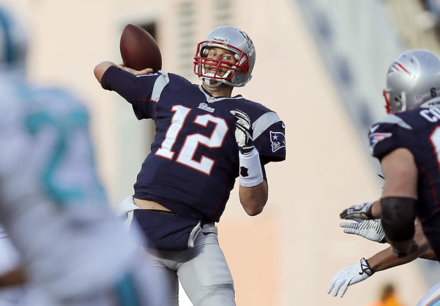 New England Patriots quarterback Tom Brady passes against the Miami Dolphins in the second half of an NFL football game Sunday, Oct. 27, 2013, in Foxborough, Mass. (AP Photo/Michael Dwyer)