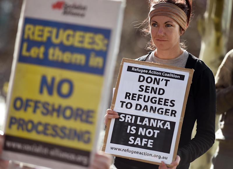 A protest against Australia's treatment of refugees delayed the tennis at the Australian Open (AFP Photo/William West)