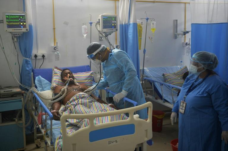 Coronavirus infections have killed at least 165,000 people in the vast South Asian nation -- home to some of the world's most densely populated cities -- since the start of April