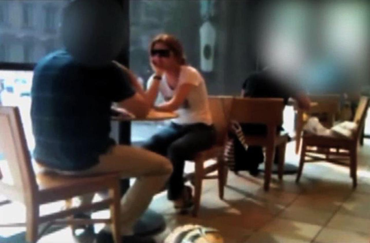 In this frame grab image from a surveillance video released by the Federal Bureau of Investigation (FBI), and partially obscured by the source, Russian spy Anna Chapman, wearing sunglasses, sits in a coffee shop in New York. The FBI has said Chapman used her laptop to transmit encrypted information from a coffee shop to a to a passing van. It is not clear whether this image shows Chapman engaged in the transmission of information, as the FBI alleges. (AP Photo/FBI)
