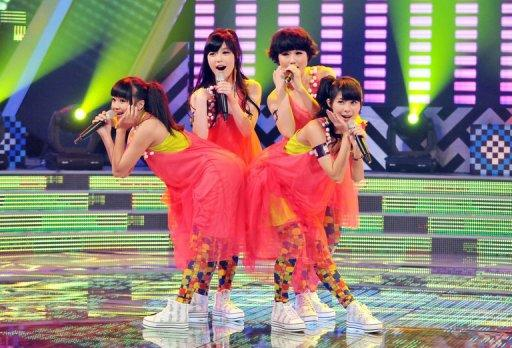 "A Taiwanese girl group is seen performing during a new talent show ""Asian Idol Group Competition,"" in Taipei, in May. With such televised contests now a major part of the global music industry, in Asia they are spurring a migration of talent between countries as performers and producers look to crack domestic, regional and global markets"