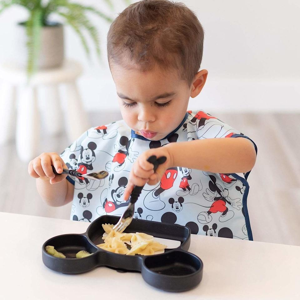 """Just call this your outfit-saving solution.<br /><br /><strong>Promising review:</strong>""""These things are a lifesaver! It took my son a little while to get used to them but he never really minded them much. They completely cover him from his shoulders to his lap and I love that if he drops food into his lap the pocket catches it. I no longer have to worry about him getting food all over himself or his clothes! He's a messy self-feeder but it's not a problem anymore thanks to these bibs!<strong>I also especially love that I can easily just wipe them down after meals so I only have to wash them once they start looking slightly stained.</strong>Then I just throw them in the wash and they come out good as new! I bought three and I'm so glad I did! If your kid is exceptionally messy, I highly recommend these!"""" —<a href=""""https://www.amazon.com/dp/B00HPQTB2A?tag=huffpost-bfsyndication-20&ascsubtag=5871416%2C19%2C27%2Cd%2C0%2C0%2C0%2C962%3A1%3B901%3A2%3B900%3A2%3B974%3A3%3B975%3A2%3B982%3A2%2C16384768%2C0"""" target=""""_blank"""" rel=""""noopener noreferrer"""">Alicia Briggs</a><br /><strong><br />Get it from Amazon for<a href=""""https://www.amazon.com/dp/B00HPQTB2A?tag=huffpost-bfsyndication-20&ascsubtag=5871416%2C19%2C27%2Cd%2C0%2C0%2C0%2C962%3A1%3B901%3A2%3B900%3A2%3B974%3A3%3B975%3A2%3B982%3A2%2C16384768%2C0"""" target=""""_blank"""" rel=""""noopener noreferrer"""">$9.95</a>(available in 15 styles).</strong>"""