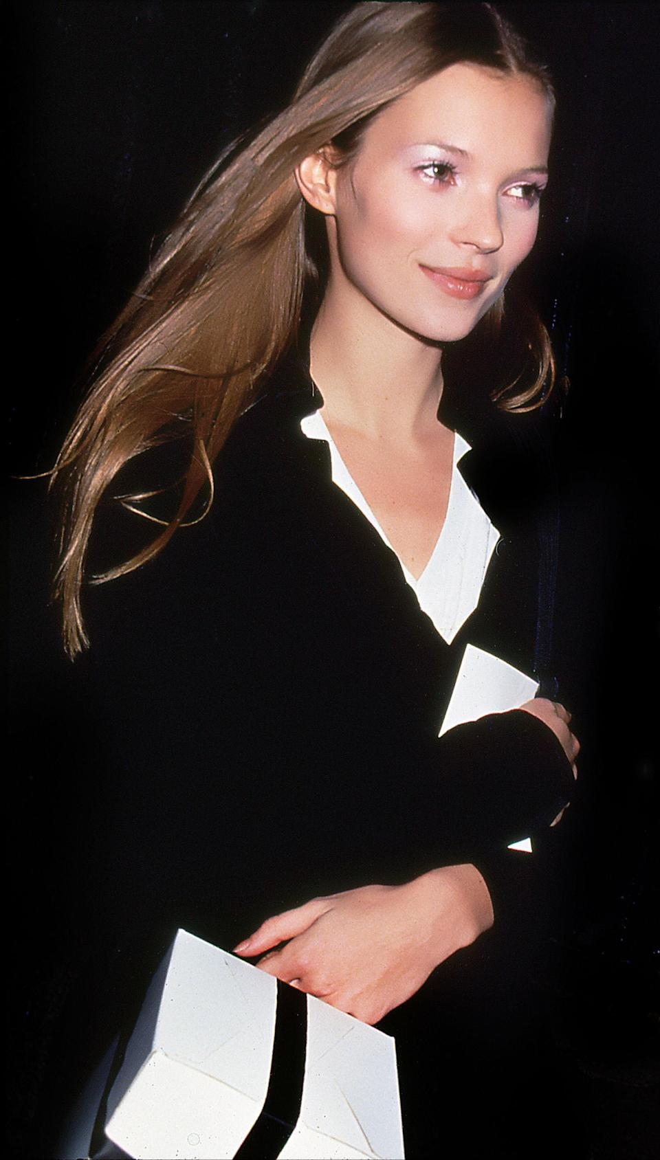 <p>Kate Moss opts for a black and white outfit for a Bryant Park Fashion Event, 1995</p>